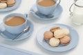 Vanilla and Chocolate Macarons with Tea Royalty Free Stock Photo