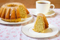 Vanilla and cinnamon bundt cake with icing cup of tea Royalty Free Stock Photos