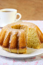 Vanilla and cinnamon bundt cake with icing cup of tea Royalty Free Stock Photo