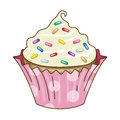Vanilla cupcake icing rainbow sprinkles with and a pink polka dot wrapper Stock Image