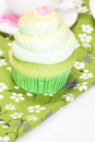 Vanilla cupcake lime icing cup coffe background Royalty Free Stock Photography