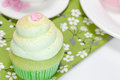 Vanilla cupcake lime icing cup coffe background Stock Photos