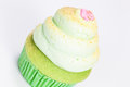 Vanilla cupcake lime icing white background Stock Photo