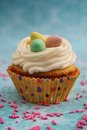 Vanilla cupcake nest three eggs top Stock Photo