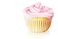Vanilla cupcake pink frosting over white background Stock Photos