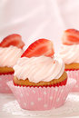 Vanilla cupcake with stawberry frosting Stock Photo