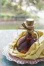 Vanilla extract homemade in yellow paper bag Stock Photo