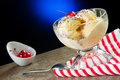 Vanilla ice cream with a cherry on top Stock Photography