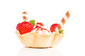 Vanilla ice cream with strawberries in a waffle cup sticks and red sauce on white Stock Photo
