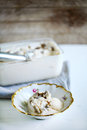 Vanilla ice cream with truffles homemade in a rustic bowl on white wooden table Stock Photography