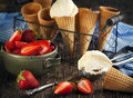 Vanilla Ice Cream in a waffle cones with strawberries Royalty Free Stock Photo