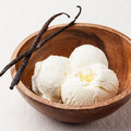 Vanilla ice cream in wooden bowl Stock Photo