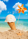 Vanilla icecream flavor with pinwheel on summer beach Stock Images