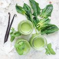 Vanilla, mint, spinach and coconut milk detox green smoothie in glass, top view, square format Royalty Free Stock Photo