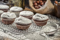 Vanilla muffins decorated with icing sugar on old wooden table Royalty Free Stock Photography