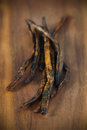 Vanilla pods from india dried on a wooden board spice Stock Image