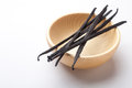 Vanilla pods in a wooden bowl Stock Photo