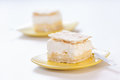 Vanilla slice with puff pastry on top of it served on a yellow plate Stock Images