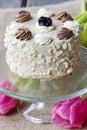 Vanilla wedding cake on cake stand Royalty Free Stock Photo