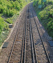 Vanishing point photo of railway track lines taken from a bridge in whitstable kent heading in the direction of faversham photo Stock Photo