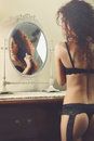 Vanity portrait boudoir of a sensual woman in lingerie focus on face conceptual Royalty Free Stock Photo