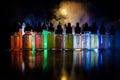 Vape concept. Smoke clouds and vape liquid bottles on dark background. Light effects. Useful as background or vape advertisement o