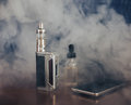 Vape devices, E-cigarette for vaping, liquid in the bottle and mobile phone
