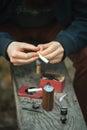 Vape. Male hands prepare cotton for an electronic cigarette.