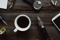 Vaping set, watch, coffee and smartphone on the wooden background. Hipster or bussinesman style.