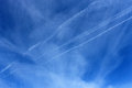 Vapor trails in blue sky scenic view of white Stock Photography