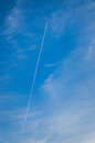 Vapour trail a airplane in a blue sky Stock Image