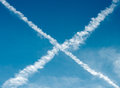 Vapour trails from aircraft forming an cross Stock Image