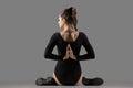 Variation of Gomukhasana yoga pose Royalty Free Stock Photo
