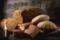 Variation of homemade bread fresh baking rye wheat and wholegrain over dark background Stock Image