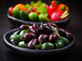 Variation of olives with raw snack vegetable in the background Stock Image