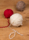 Varicolored balls of yarn ball on a wooden background Royalty Free Stock Photography