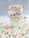 Varicolored marshmallows in antique cups.