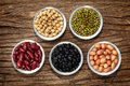 Varieties of beans on the wood background Royalty Free Stock Images