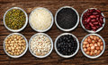 Varieties of grains on the wood background Stock Photos