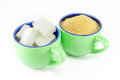 Varieties of sugar in two cups of coffee Royalty Free Stock Photo