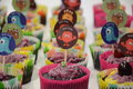 Variety of brightly decorated cupcakes assortment Stock Photos