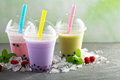 Variety of bubble tea in plastic cups Royalty Free Stock Photo