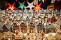Variety of ceramic houses and star garlands at traditional Christmas market in Strasbourg Royalty Free Stock Photo