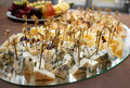 Variety of cheese on mirror platter banquet table catering event Stock Photography