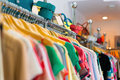 Variety of clothes hanging on rack in boutique Stock Photography