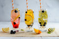 Variety of cold lemonade with fruit and berries Royalty Free Stock Photo