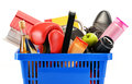 Variety of consumer products in plastic shopping basket on white Stock Photography