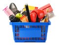 Variety of consumer products in plastic shopping basket on white Royalty Free Stock Photo