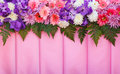 Variety flowers on pink fabric background stunning copy space Stock Image