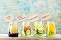 Variety of fruit infused detox water in jars Royalty Free Stock Photo